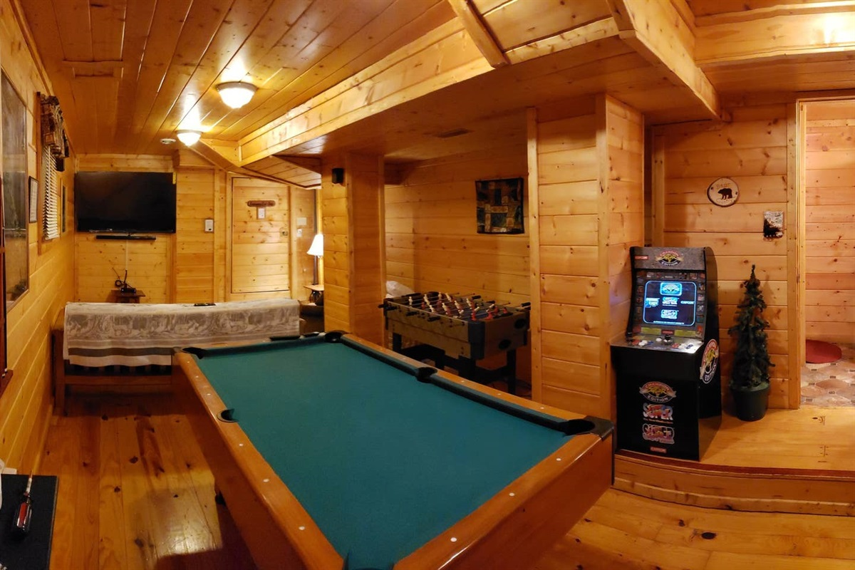 "Gameroom/Basement w/ Movie Corner New 65"" smart curve TV, arcade, foosball game/air hockey table, and pool table. You or your kids won't be bored even you choose to stay in and relax."