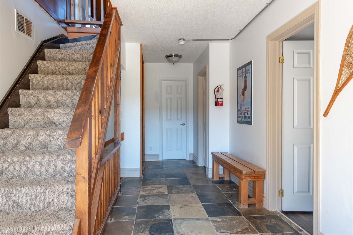 Foyer, hallway and stairs to upper level