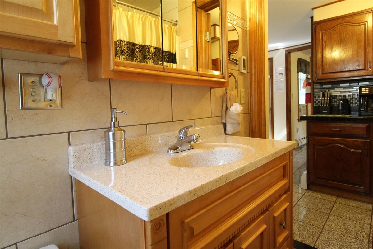 Modern, fully tiled bath with heated floor