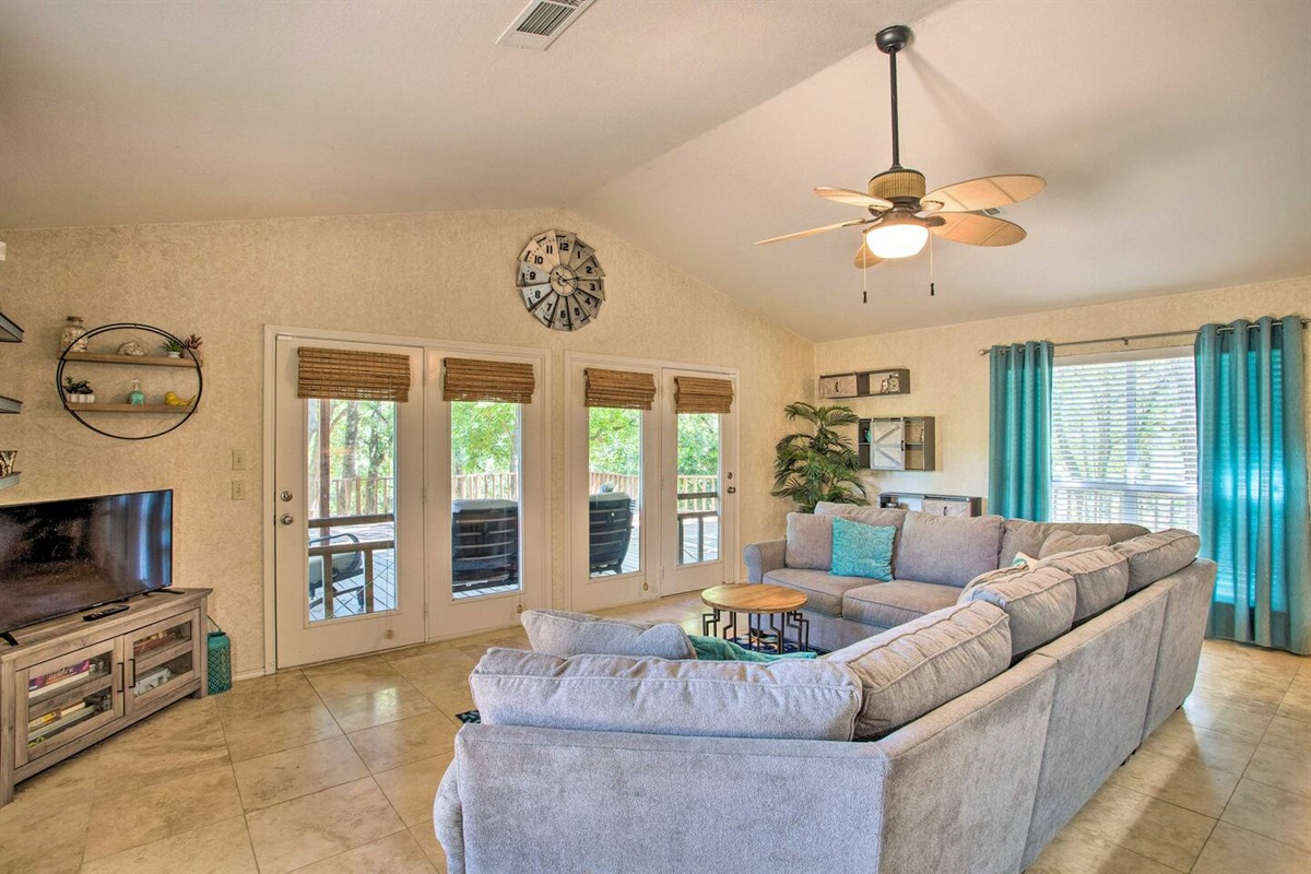 Living room with access to outside patio and deck.