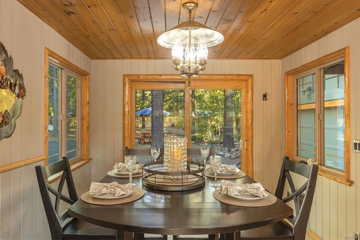 Dining Room: Big table with seating for 6 located next to kitchen with access to deck.