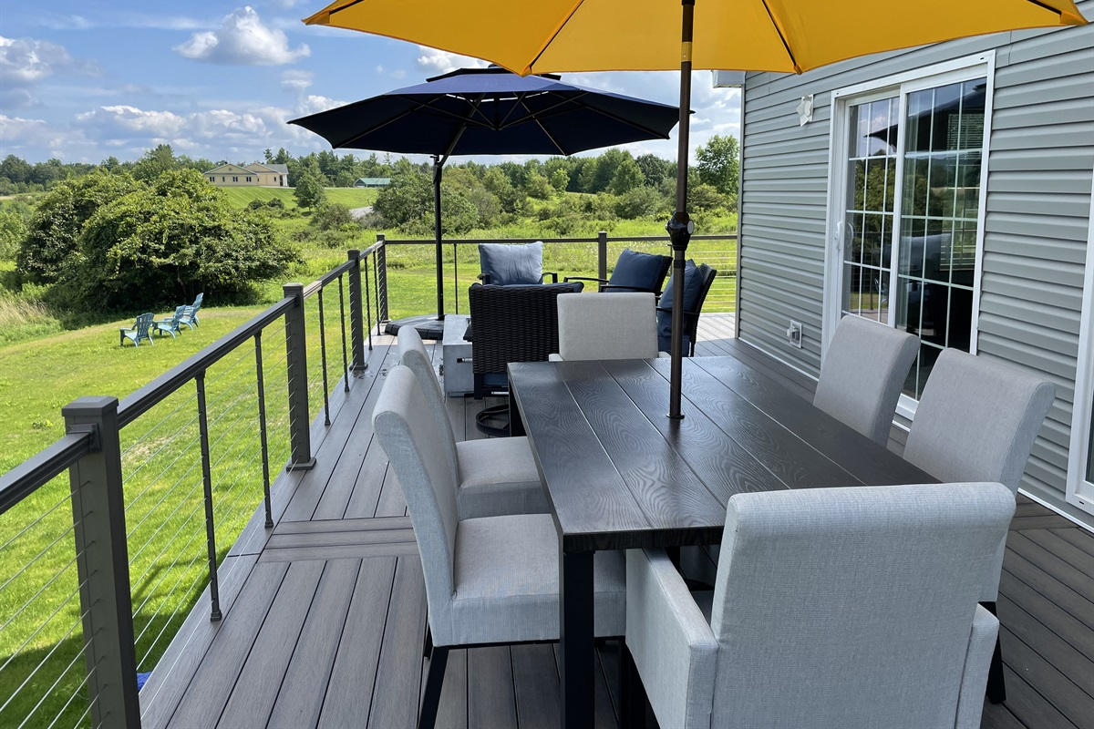 Outdoor dining and lounge area on wrap around porch.