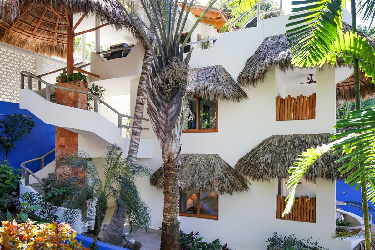 Entrance to Villas Palmas Reales, bedrooms middle floor, kitchen, pool and patio on top floor.