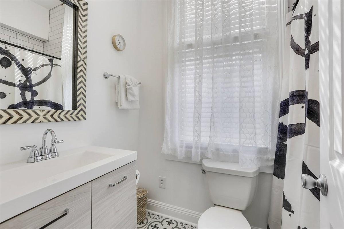 Full bathroom with shower/tub.