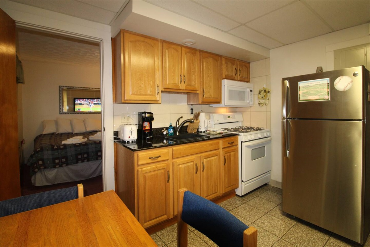 Well equipped kitchen with gas range, microwave, refrigerator with automatic ice maker, k-cup and regular coffee brewers, toaster and more for all the comforts of home.