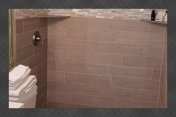 A brand new tiled shower has been added to the second bathroom