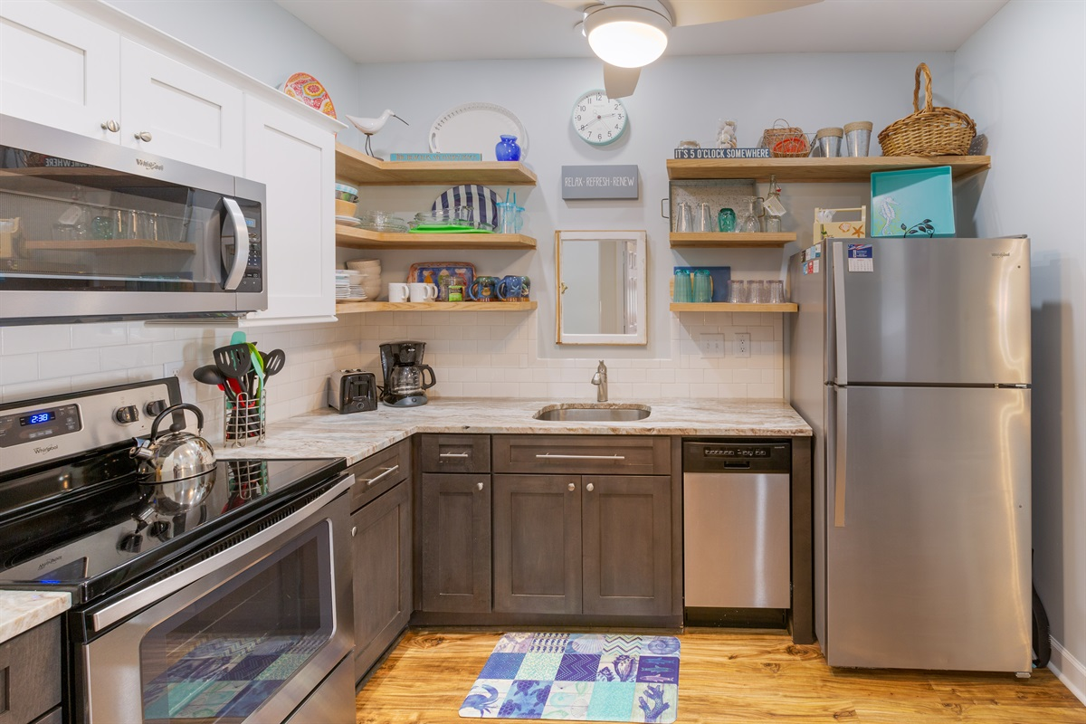 Provisions include coffee maker, electric kettle, toaster, crock pot, microwave, dishwasher