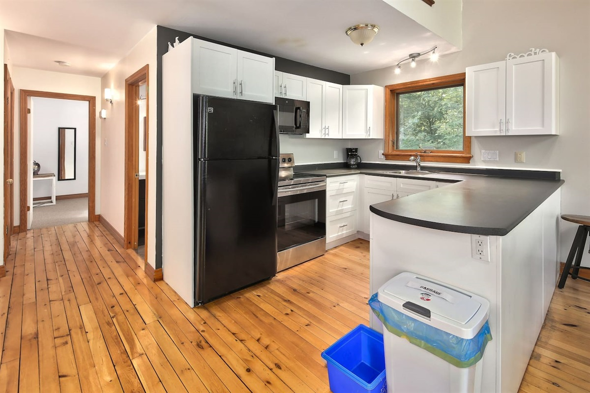 Prepare meals together in the spacious fully stocked kitchen