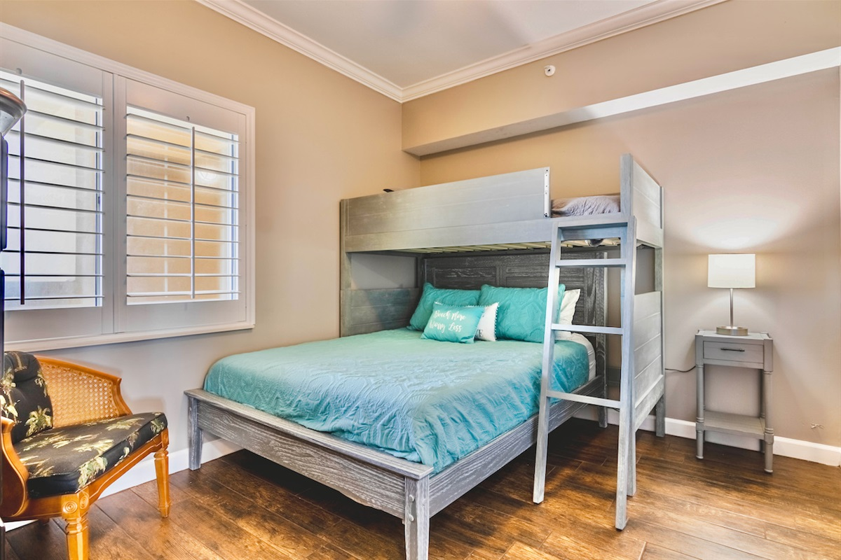 smaller bedroom with queen bed and twin loft  bed  flat screen tv