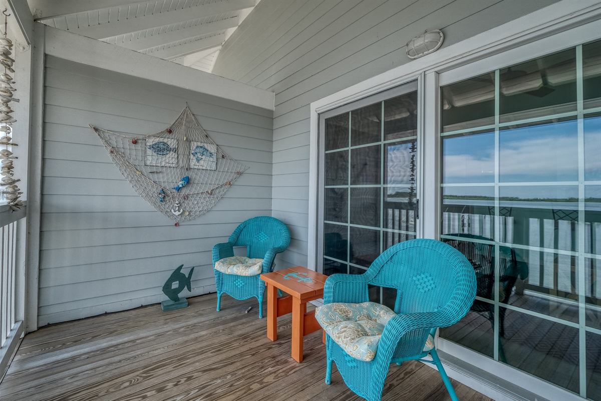 Sliding glass doors of of living space lead to a private porch