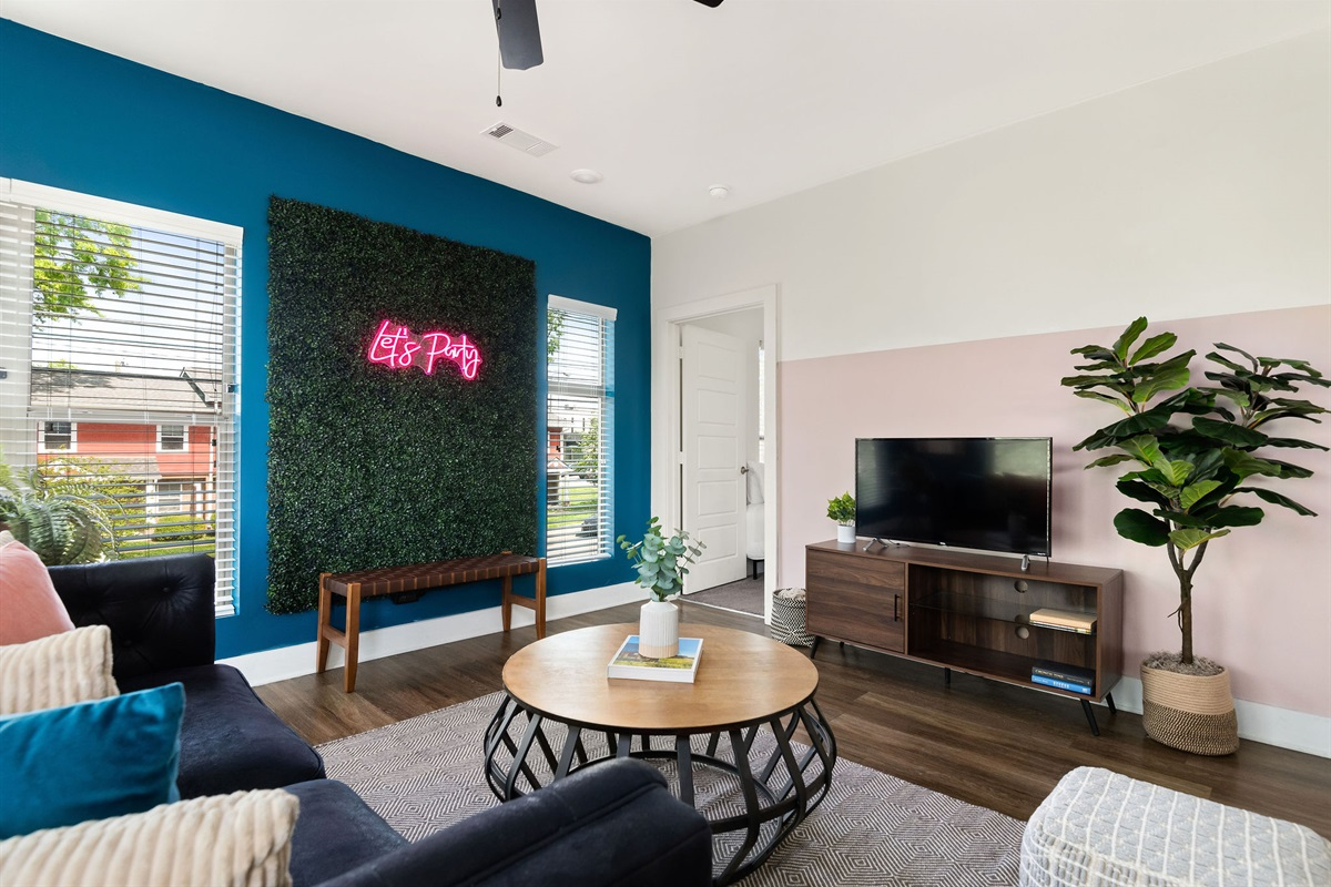 Relax as a group in the comfortable living room.  Includes a Roku Smart TV and a record player for your entertainment!