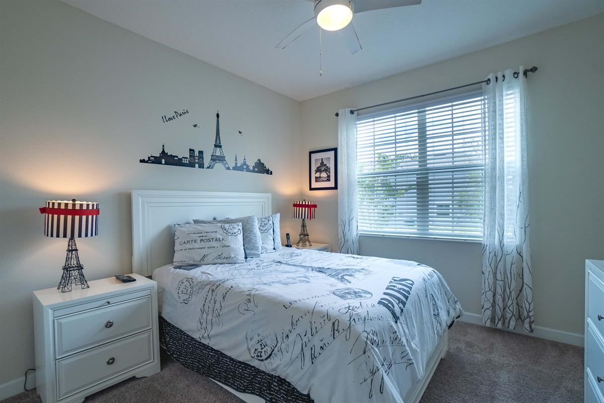 Queen Paris themed bedroom with TV