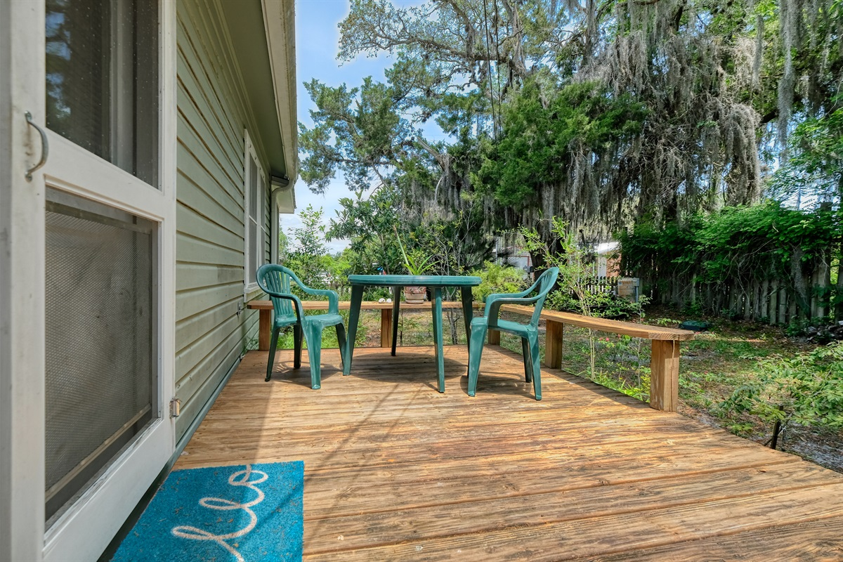 Deck on side of house with seating