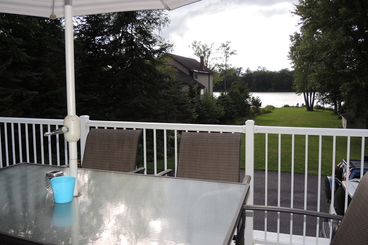 View of lawn and water from roof deck