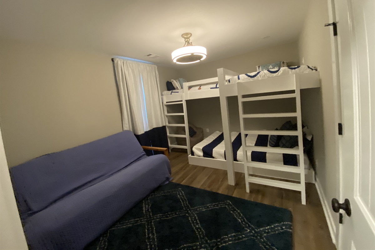 Kids hang out area with XL Twin loft beds, a Queen bed on bottom and a Futon.